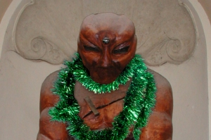 Golem shown trying on green tinsel.